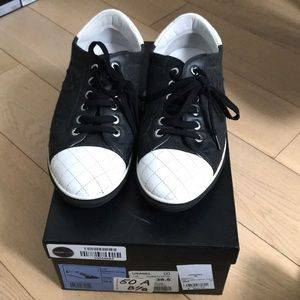 Chanel cap toe sneakers is dark grey